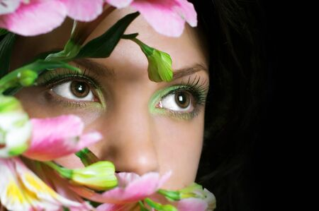Woman with pink flowers  Focus on eyes Stock Photo