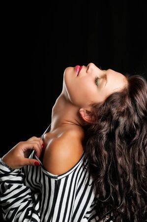 art fashion photo of portrait young woman on dark background Stock Photo