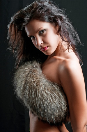 beautiful sexy girl in fur on black