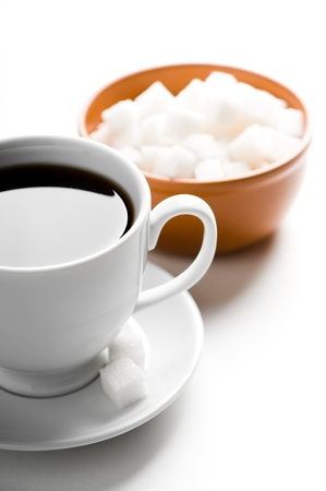 Cup of coffee and plate with sugar Stock Photo - 12815308