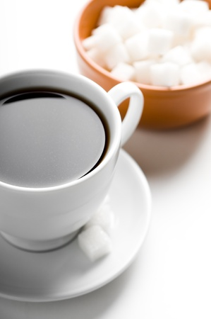 Cup of coffee and plate with sugar Stock Photo