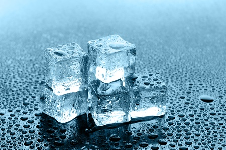 wet ice cubes on black glossy background Stock Photo - 12815821