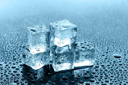 wet ice cubes on black glossy background Stock Photo