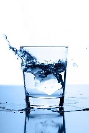 water splash in glass with ice Stock Photo