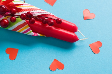 red candles and hearts on blue Stock Photo