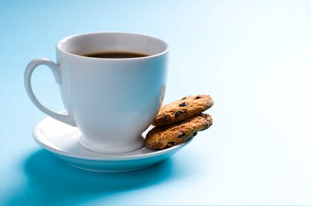 Coffee cup with cookies on blue background Stock Photo - 12815660