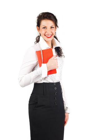 Smiling brunette business woman with organizer isolated on white background Stock Photo - 13304511