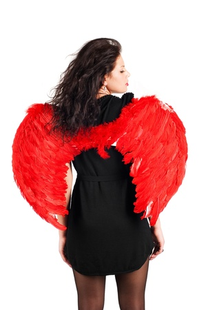 Beautiful girl with red angel wings isolated on white