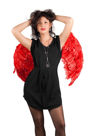 Beautiful sexy girl with red angel wings isolated on white