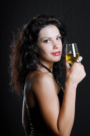Beautiful girl with wine glass on black