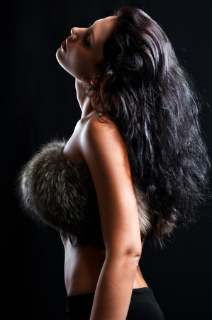 beautiful sexy girl in fur on black photo