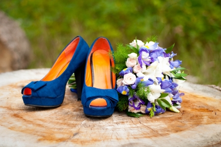 Blue wedding accessories on wood photo