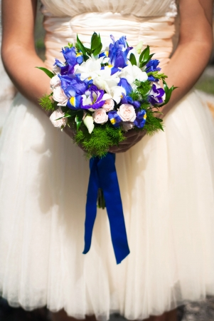 wedding bouquet at bride s hands photo