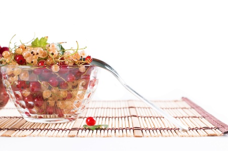 Fresh Raspberry and currant in a crystal bowl isolated Stock Photo
