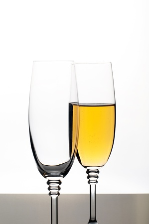 Two glasses of champagne or wine isolated on white