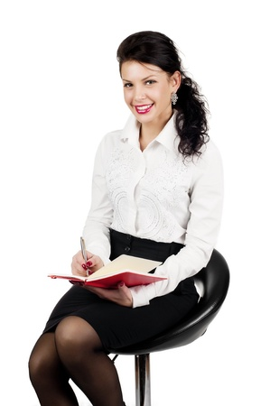 smiling brunette business woman with organizer isolated on white background