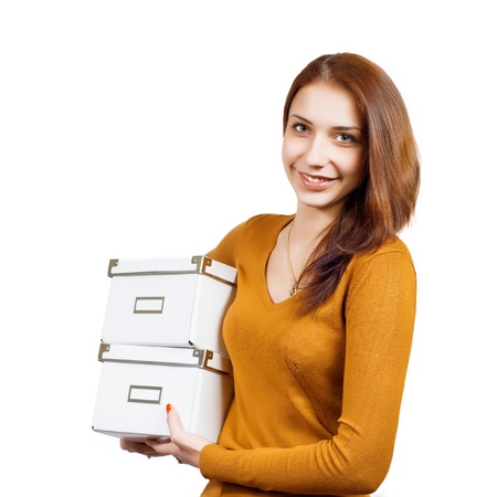 Attractive young woman with parcels over white Stock Photo