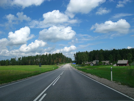 The road in forests of Estonia Stock Photo