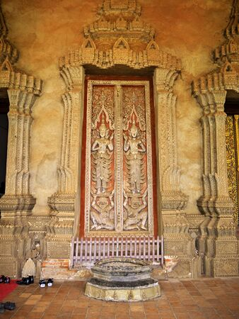 The ancient Wat in Vientiane, Laos 免版税图像