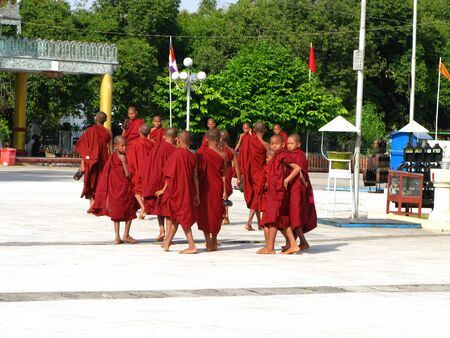Yangon  Myanmar - 04 Jan 2010: Monks in the ancient temple in Yangon ( Rangoon ), Myanmar