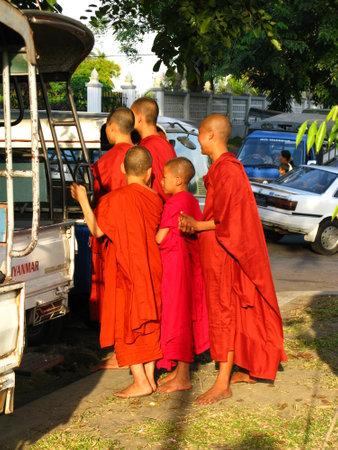 Yangon  Myanmar - 04 Jan 2010: Monks in Shwedagon pagoda ( temple ), in Yangon ( Rangoon ), Myanmar Redakční