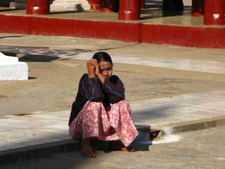 Bagan  Myanmar - 06 Jan 2010: The woman in Shwezigon Pagoda in Bagan, Myanmar Sajtókép