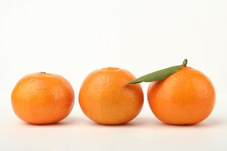 Ripe tangerines on a white background  photo