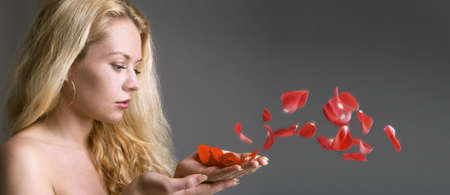 The girl with petals of a rose photo