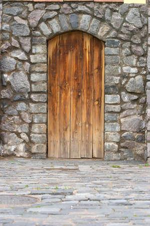 Wooden door in an old wall Stock Photo - 1456475