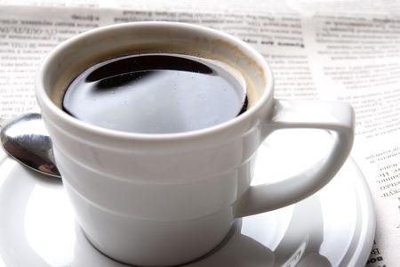 exceeds: Coffee, news Stock Photo