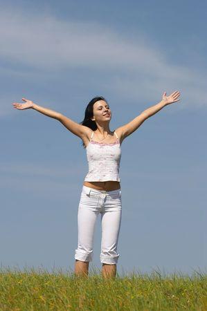 The cheerful girl, grass, the sky, horizon, photo