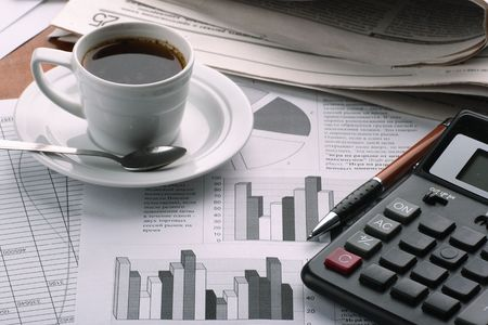 Cup of fragrant coffee on a morning paper business news Stock Photo - 2513040