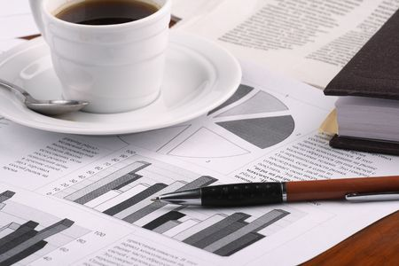 Cup of fragrant coffee on a morning paper business news Stock Photo - 2513037
