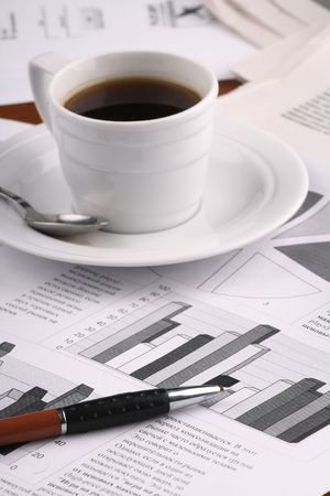 Cup of fragrant coffee on a morning paper business news Stock Photo - 2513035