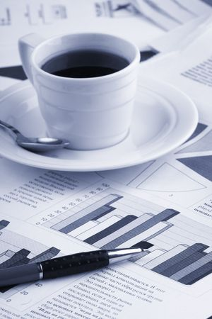 Cup of fragrant coffee on a morning paper business news Stock Photo - 2513036