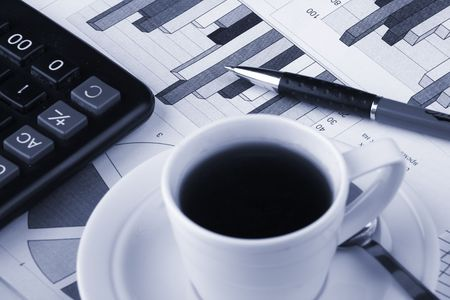 Cup of fragrant coffee on a morning paper business news Stock Photo - 2513041