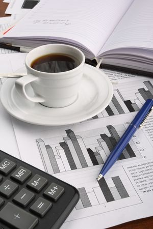 Cup of fragrant coffee on a morning paper business news Stock Photo - 2513038