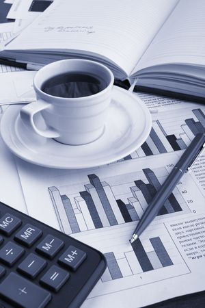 exceeds: Cup of fragrant coffee on a morning paper business news
