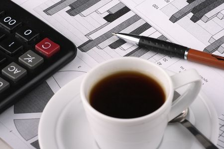 Cup of fragrant coffee on a morning paper business news Stock Photo - 2531168