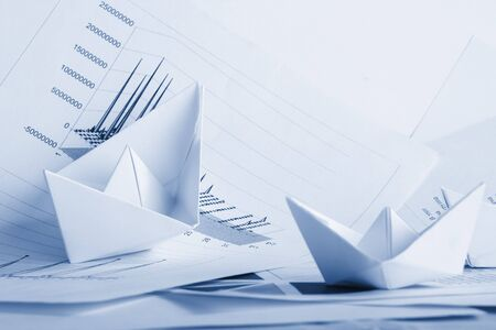 Business concept, paper boat and documents Stock Photo - 3086269