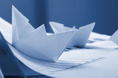 Business concept, paper boat and documents Stock Photo - 3086263