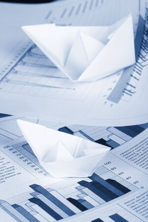 Business concept, paper boat and documents Stock Photo - 3199572