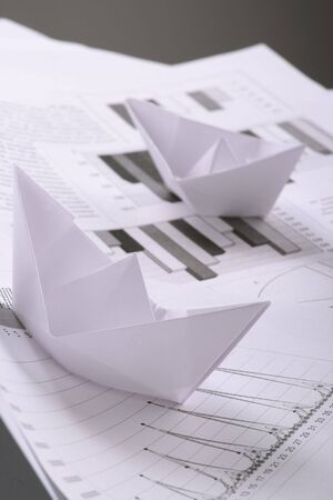 Business concept, paper boat and documents Stock Photo - 3471298