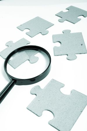 seeking an answer: Magnifying glass, puzzle Stock Photo