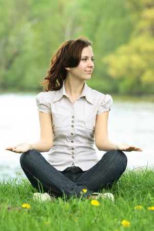 pacification: young woman doing meditation