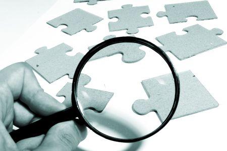 investigators: Magnifying glass, puzzle Stock Photo