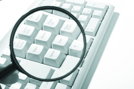 Magnifying glass, button, key Stock Photo - 3961035