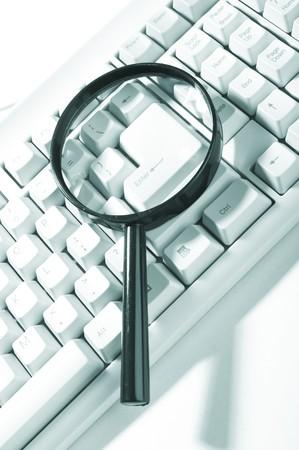 investigators: Magnifying glass, button, key
