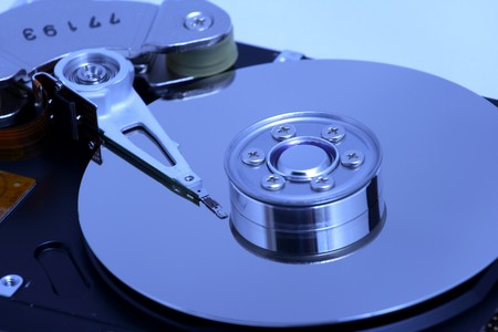 Hard disk detail with a blue hue photo