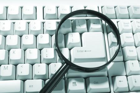 Magnifying glass, button, key Stock Photo - 4423291